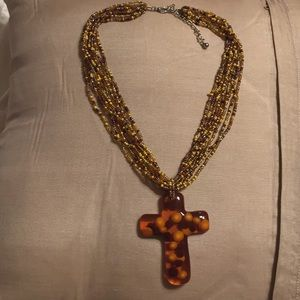 Glass cross on beaded necklace